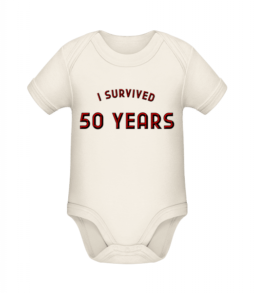 I Survived 50 Years - Organic Baby Body - Cream - Front