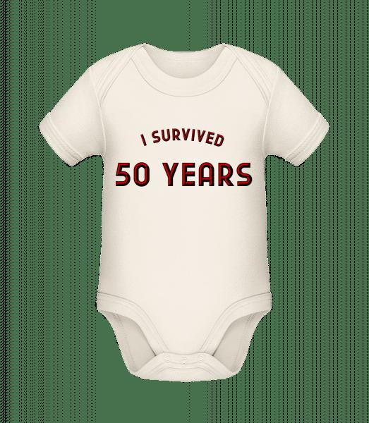 I Survived 50 Years - Baby Bio Strampler - Creme - Vorn